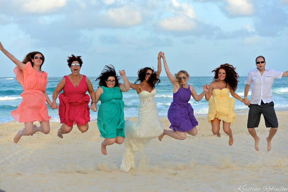 bride jumps with bridesmaids