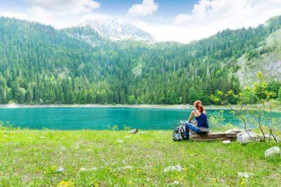 traveler is resting at the lake P9QECJZ