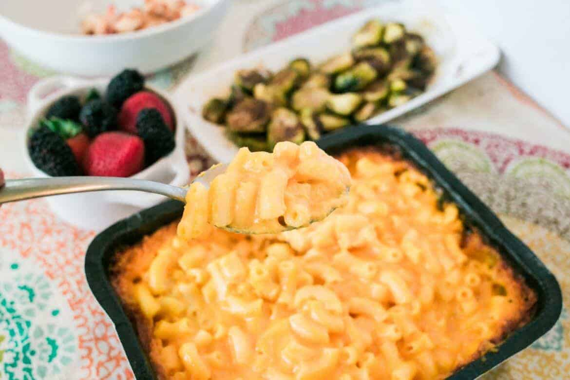 spoonful of mac and cheese above a serving dish for an Easy Weekday Dinner