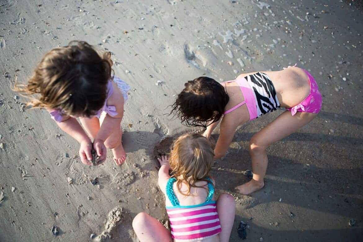 Young girls playing in the sand at the beach Summer Emergency Preparedness Kit