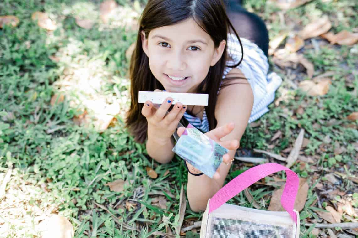 young girl holding a polaroid picture the creative way my kid is surviving deployment