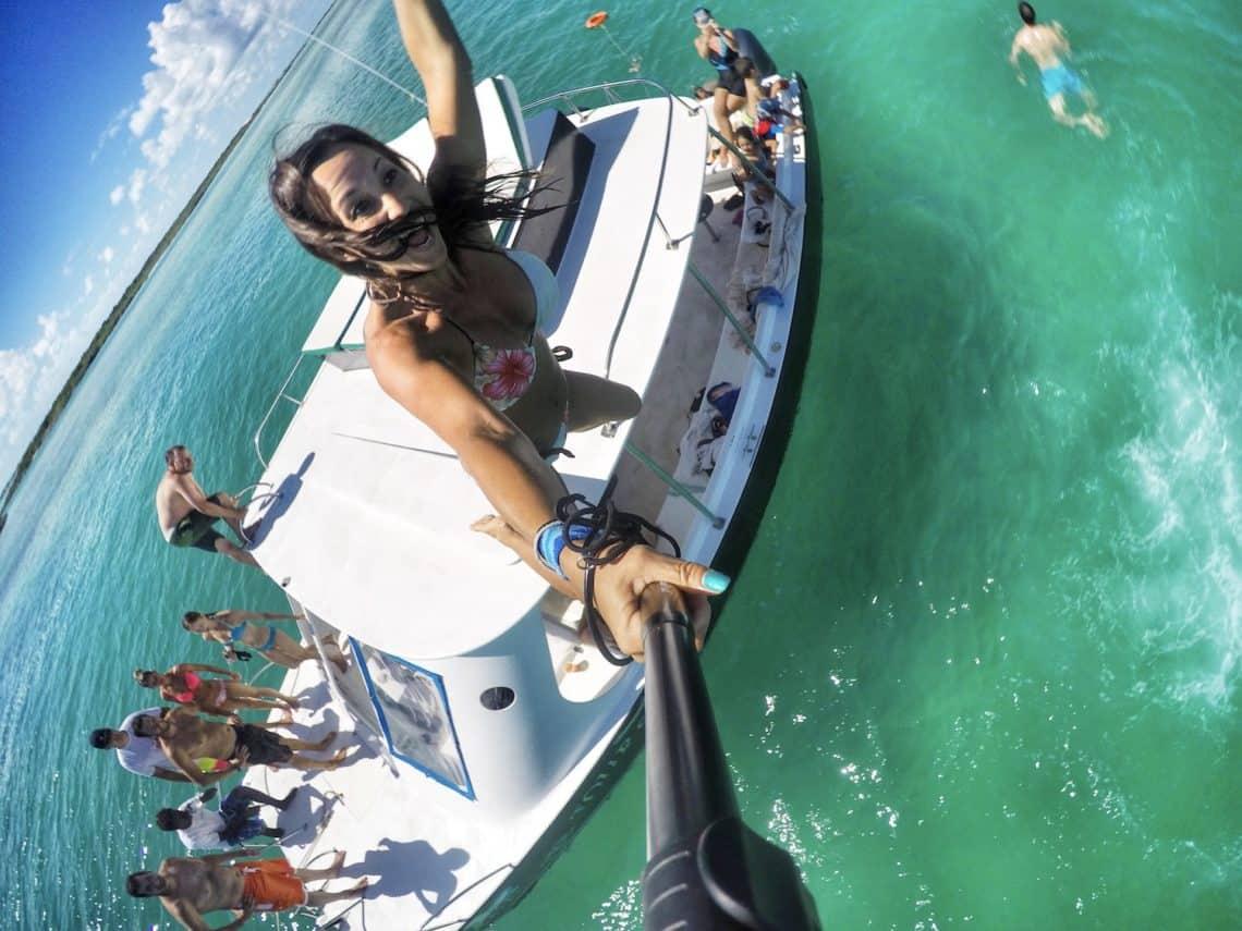 girl jumping off boat in ocean