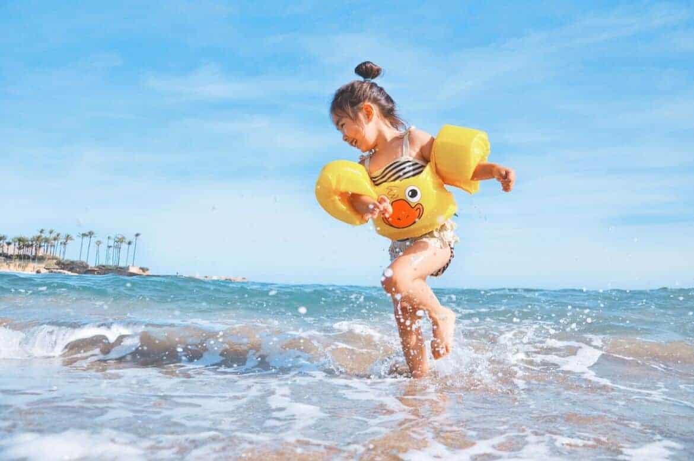 girl water beach playing splash