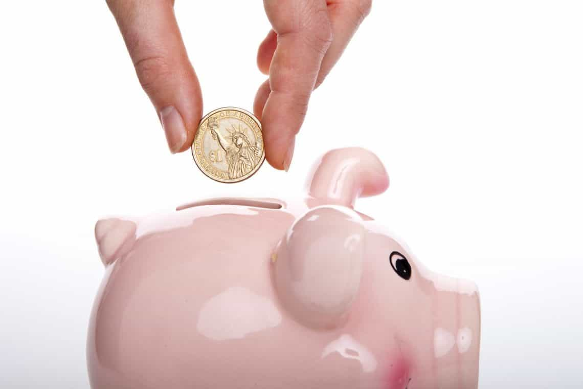putting coins in a piggy bank creative ways to save money