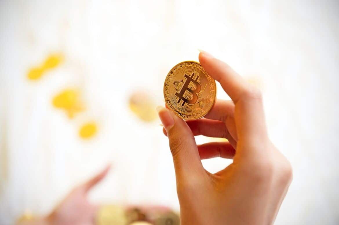 """So you've finally gotten around to purchasing your first cryptocurrency. Now what? It's not enough to keep your cryptocurrencies on an exchange, gradually increasing or decreasing in value. Best practice suggests that cryptocurrency investors should immediately move their coins into a hot or cold storage wallet. But what exactly is a cryptocurrency wallet, and what is the difference between hot and cold storage? Why move cryptocurrencies off of exchanges? While it's super convenient to leave cryptocurrencies on the exchanges from where you bought them, this comes with two problems. One problem is that you don't own your coins when they're sitting on an exchange. Similar to how central banks handle money, centralized cryptocurrency exchanges are still technically holding your coins in reserve. They can use their reserve holdings as they see fit. And this leads to the second problem: if something happens to the exchange, such as a major hack, they may lose all of their reserve coins and not pay back the traders. Scenarios like this have happened many times before. Essentially, leaving your cryptocurrencies on an exchange leaves them open to a single point of failure. Additionally, as the saying goes, """"not your keys, not your crypto."""" In other words, the only way to truly own your cryptocurrencies is to own the storage method. What are cryptocurrency storage wallets? Cryptocurrency wallets can be software or hardware-based. Software wallets are apps or programs that you can download to your PC or smartphone. Hardware wallets can be USB drives or paper wallets. When you transfer funds from an exchange to a cryptocurrency wallet, the wallet will usually require you to set up a passphrase, or """"seed phrase,"""" to access your funds. Seed phrases are the keys referred to in the saying mentioned above, """"not your keys, not your crypto."""" The seed phrase often comes in the form of 24 words that you'll need to memorize or write down. Seed phrases are your private keys, and no one e"""