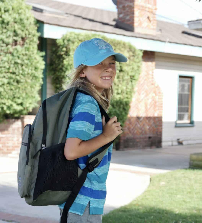 boy smiling on last day of school