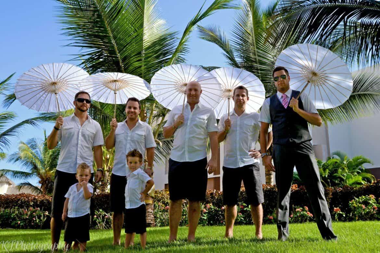 fun bridal party photo groomsmen carrying parasols