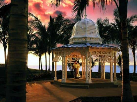 Gazebo Sunset Couple 560x420 - Destination Wedding Guide: Grand Lucayan, Bahamas