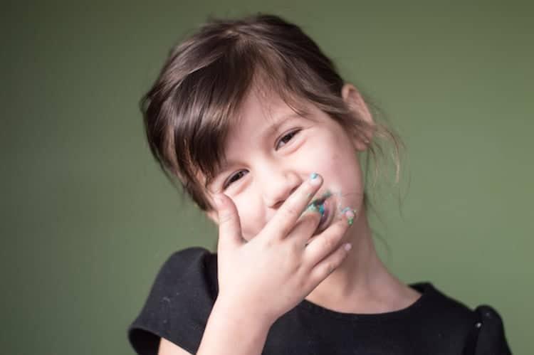 Girl Eating Frosting