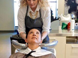 woman washing clients hair