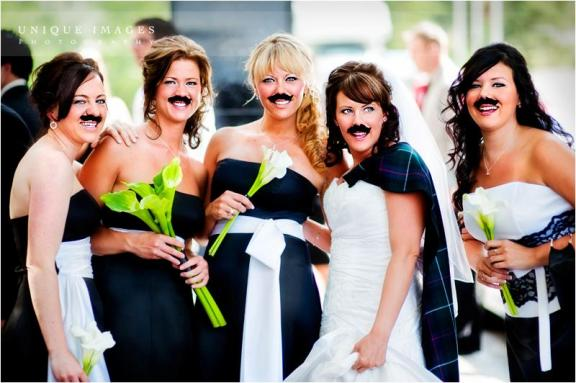 fun-bridesmaids-photo-wearing-mustaches-white-black-bridesmaids-dresses-green-white-calla-lillies