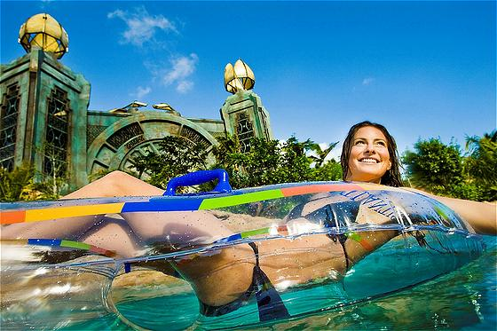 A mile-long river expedition with four-foot waves pushing inner tube riders through a densely landscaped, tropical jungle of rapids, underground tunnels, tidal waves and Tower slides. The complex 'transportainment' system allows riders to float along the river or join in a queue for water slides without leaving their inner tubes.
